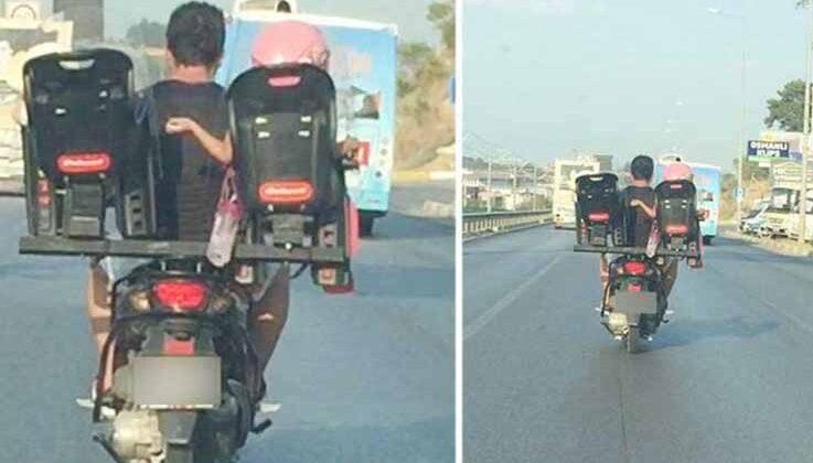 Antalya'da trafikte akıl almaz görüntü: motosiklet sürücüsü baba iki çocuğunu böyle taşıdı